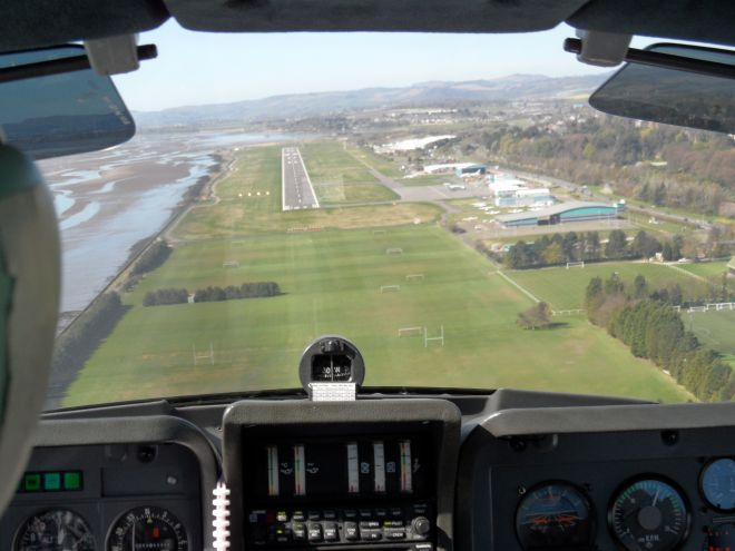 A bit high on final for Dundee 27. Tayside Aviation has the grass parking on the right