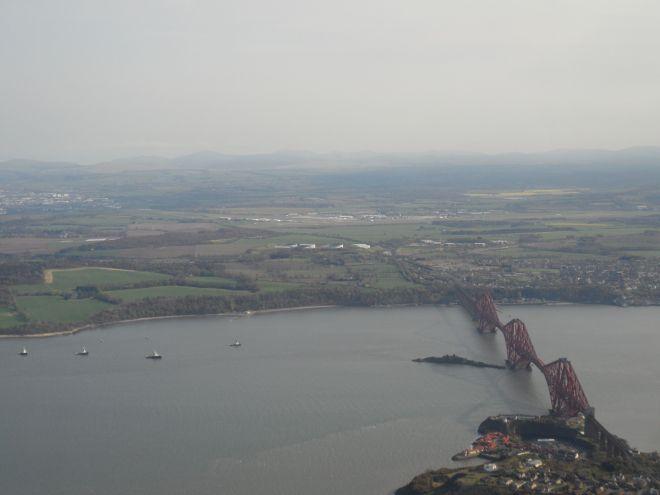 Forth Rail Bridge with Edinburgh airport on far side